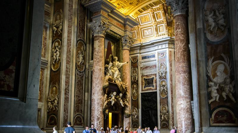 Statues on the top of Saint The interior of Saint Peter Basilica in Rome, Italy stock photos