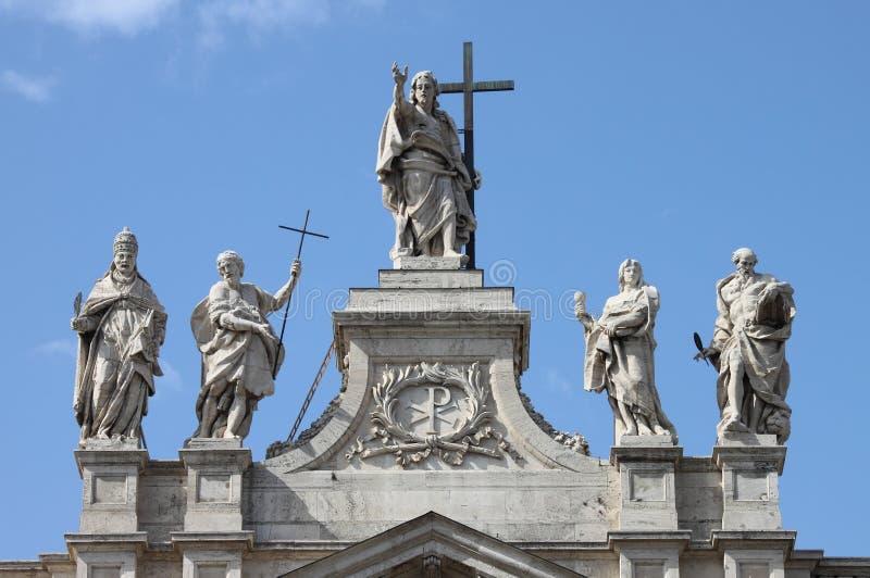 Statues on the top of Saint John Lateran Basilica royalty free stock photo