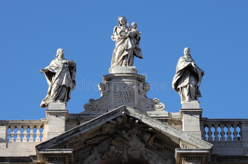 Statues on top of Saint Mary Major Basilica in Rome royalty free stock photo