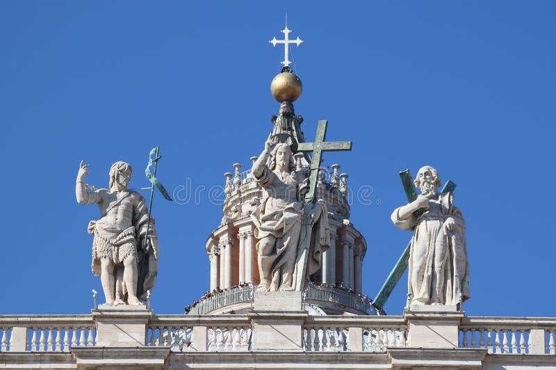 Statues on the top of Saint Peter Basilica facade stock photos