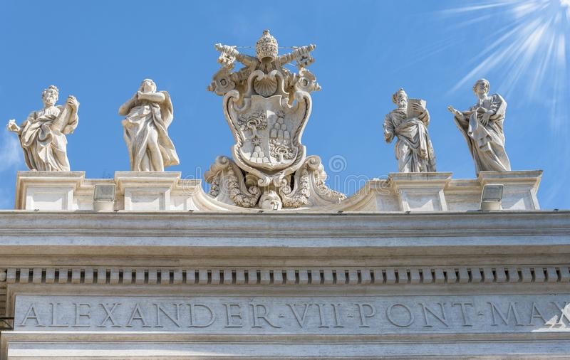 Statues on top of San Pietro. Statues on the facade of St. Peter`s cathedral. Rome, Italy royalty free stock photo