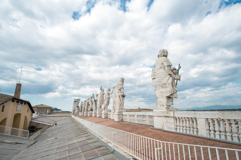 Statues on the top of St Peter`s Basilica royalty free stock images
