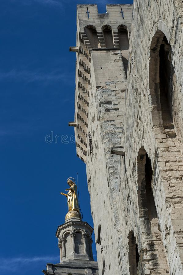 Statues and tower at the Palace of the Popes in Avignon, France.  royalty free stock photo