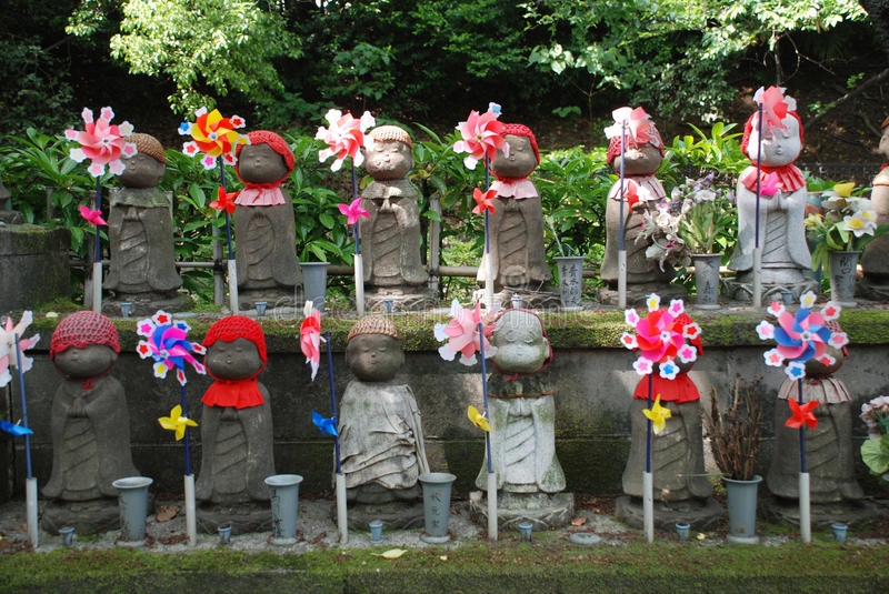 Statues for Unborn Children. Jizo statues for unborn (miscarried, aborted or stillborn) children in a shady cemetary at Zojo-Ji Temple in Tokyo. Jizo is a stock photography