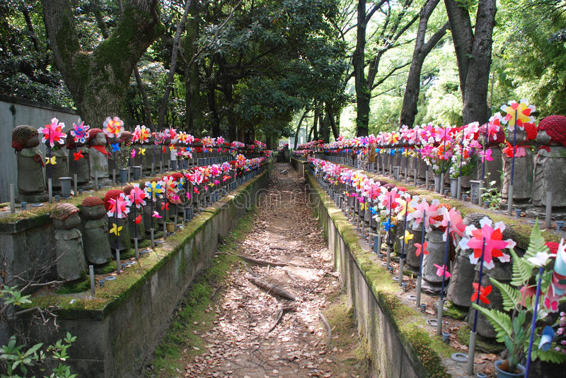 Statues for Unborn Children in Tokyo. Statues for unborn children in a shady cemetary at Zojo-Ji Temple in Tokyo stock photography