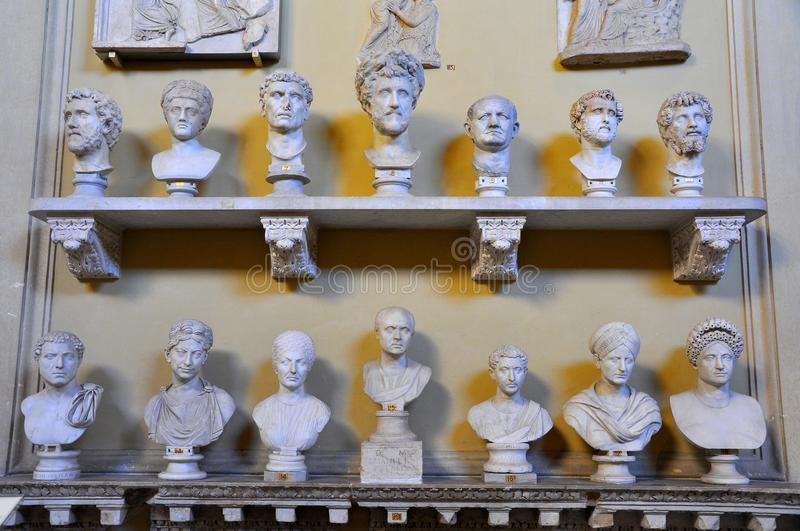 Statues at the Vatican Museum. Statue room with many busts at the Vatican Museum in Rome . Ancient statues displayed on shelves for tourists stock image