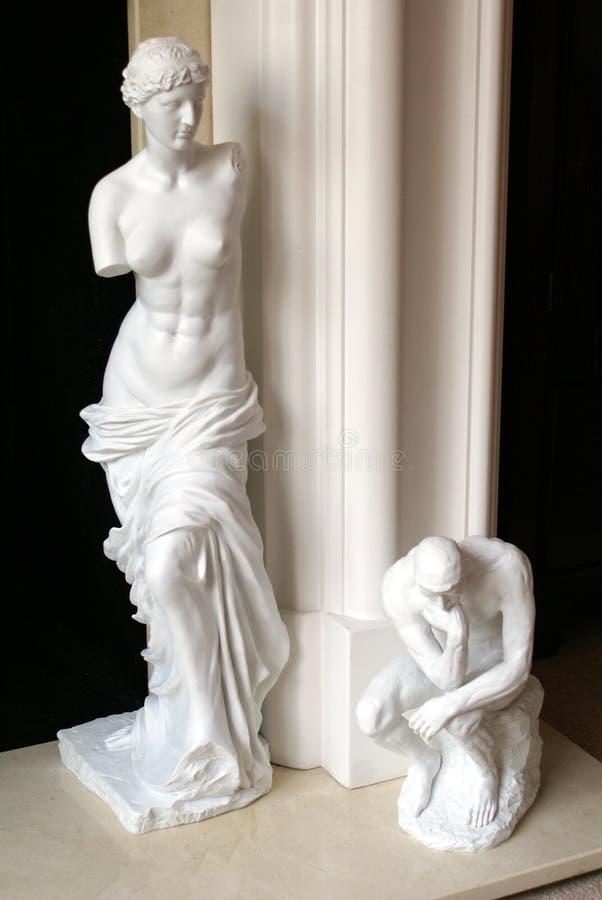 Statues Of Venus De Milo & A Man Sitting Thinking Stock Image ...