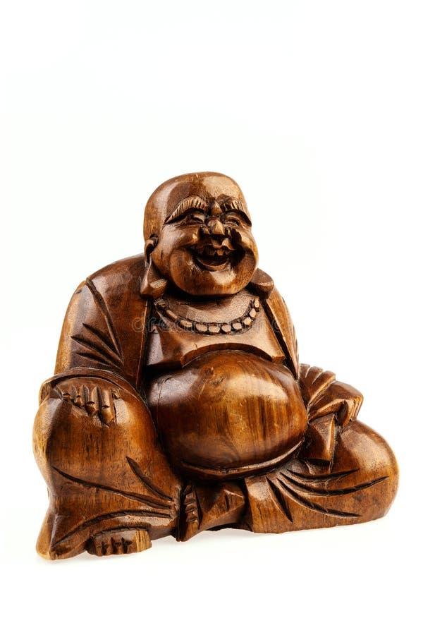 Statuette d'isolement d'un Bouddha heureux sur un fond blanc photo stock