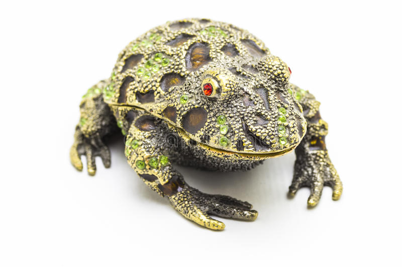 Statuette of a frog. Close up on a white background stock image