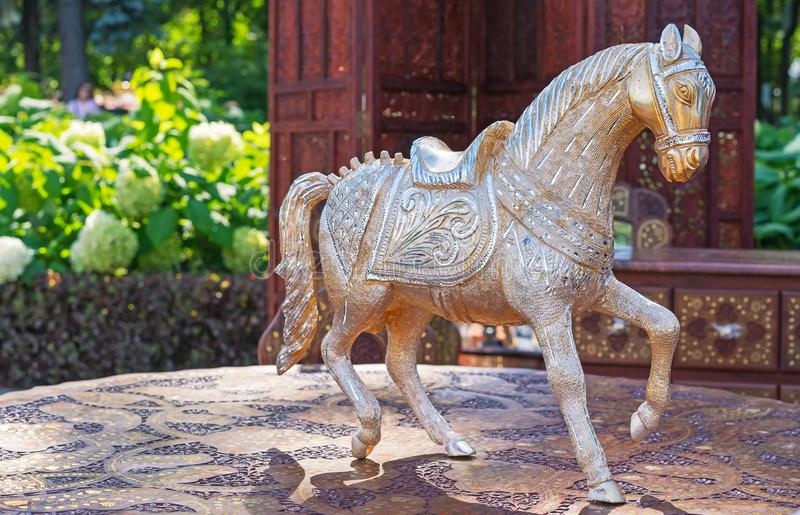 Statuette of a horse. Brass horse figurine in a gift shop.  royalty free stock image