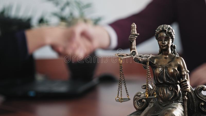 Statuette of lady justice on the table close-up stock image