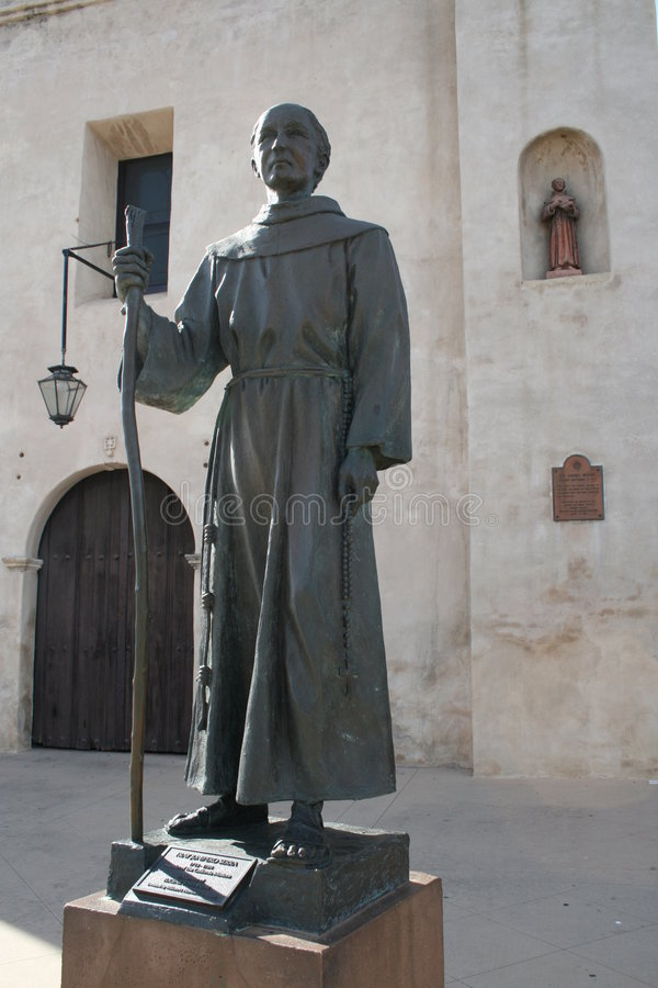 Stature of Fray Junipero Serra. The Stature of Fray Junipero Serra standing in front of the San Gabriel Mission royalty free stock photography