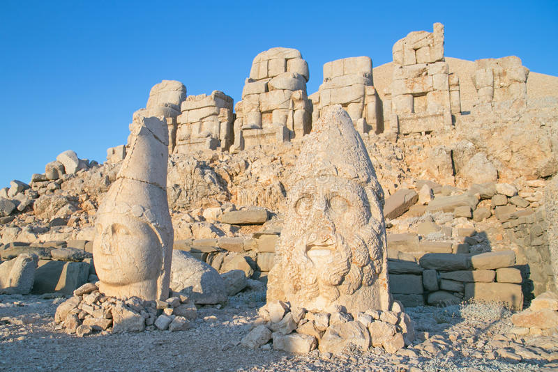 Status at Mount Nemrut. East terrace of Mount Nemrut at sunrise with the head in front of the statues. The UNESCO World Heritage Site at Mount Nemrut where King stock images