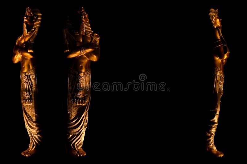 Statuy kr?lewi?tka pharaoh egipskich bog?w religii nie?ywy symbol odizolowywaj?cy na czarnym tle zdjęcie royalty free