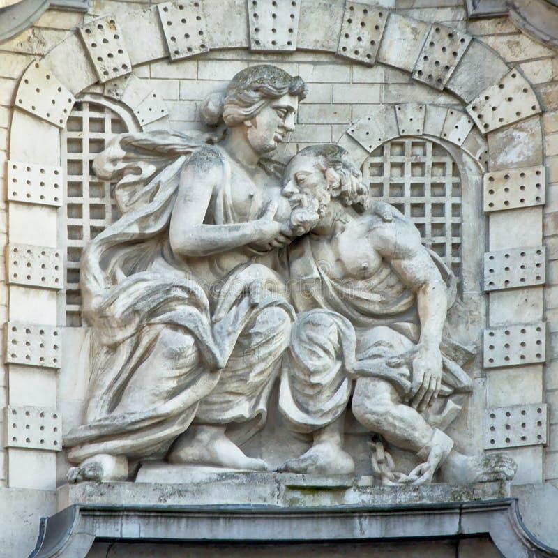 Staty av David 't Kindt, på den Ghent linnekorridoren som visar legenden av 'Mamelokker', royaltyfria foton