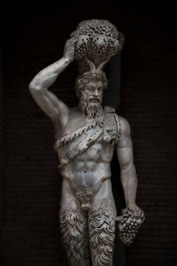 Staty av en demon på Capitoline, Rome, Italien royaltyfria bilder
