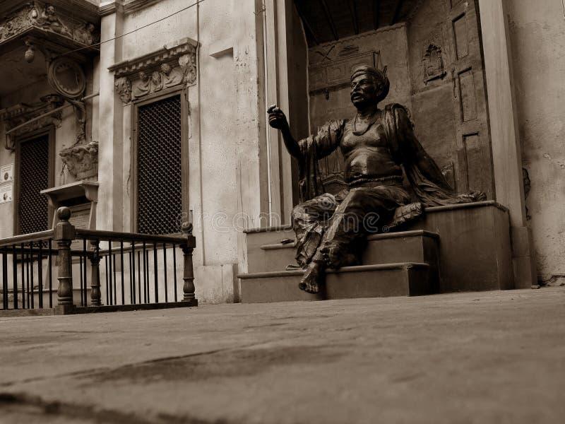 Staty av poeten arkivbild