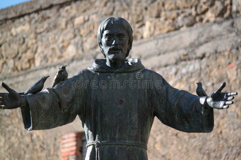 Staty av St Francis arkivbild