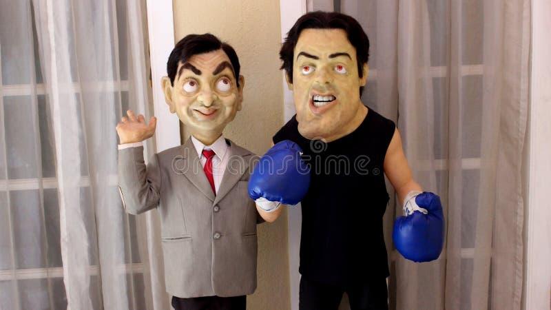 Staty för herr Bean och Sylvester Stallone royaltyfri bild