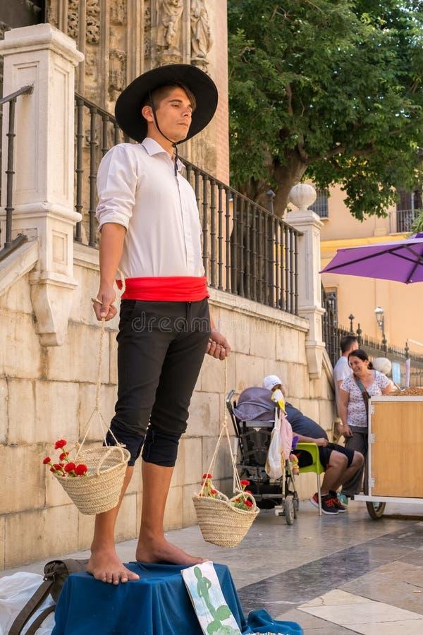 Staty för människa för spanjorfiskförsäljare royaltyfria foton