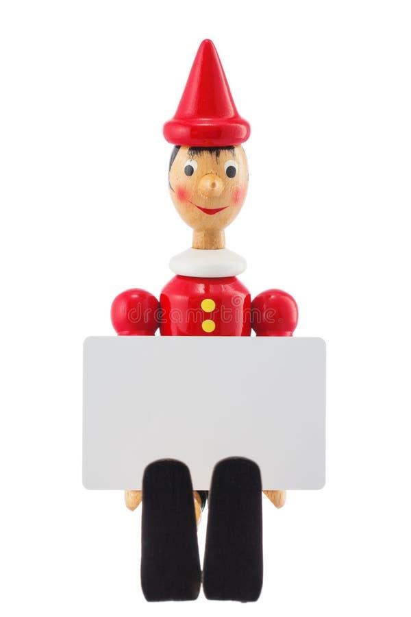 Staty för Pinocchio lögnareleksak och isolerad studio för tomt kort arkivbilder