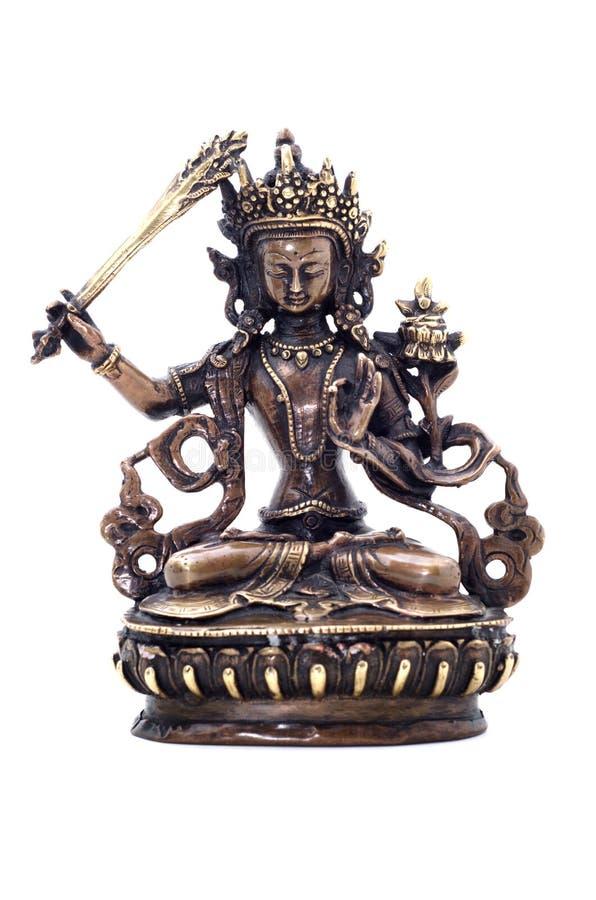 Statyett av Manjushri som svänger svärdet av vishet royaltyfria bilder
