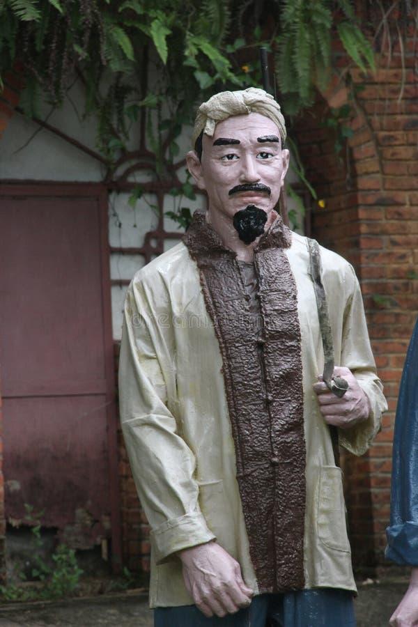 Statyn av byinvånaren i den Parkï för röd armé ¼en Œshenzhen, porslin arkivfoto