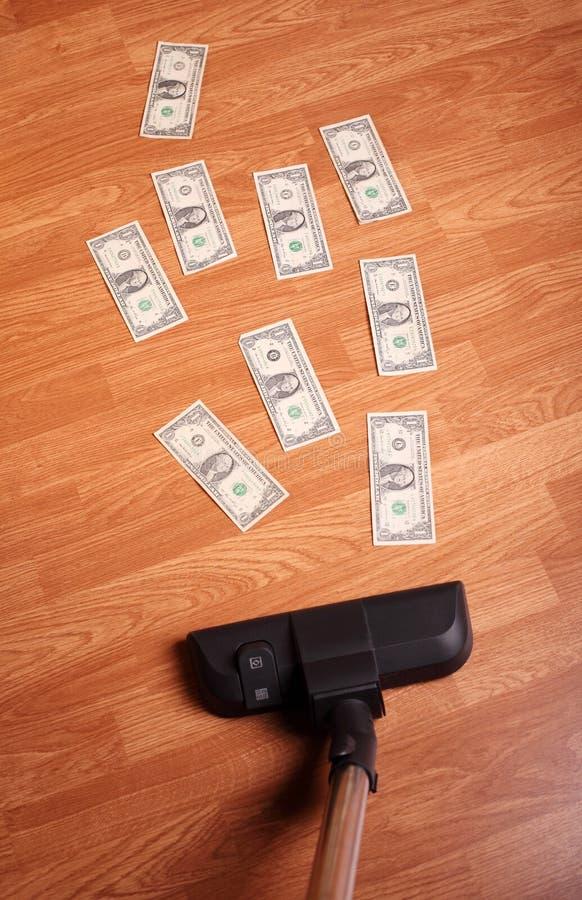 Staubsauger mit Geld lizenzfreies stockbild