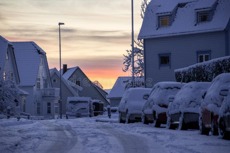 Stavanger Norway snow covered cars at sunrise. Stavanger Norway snow covered cars sunrise stock photo