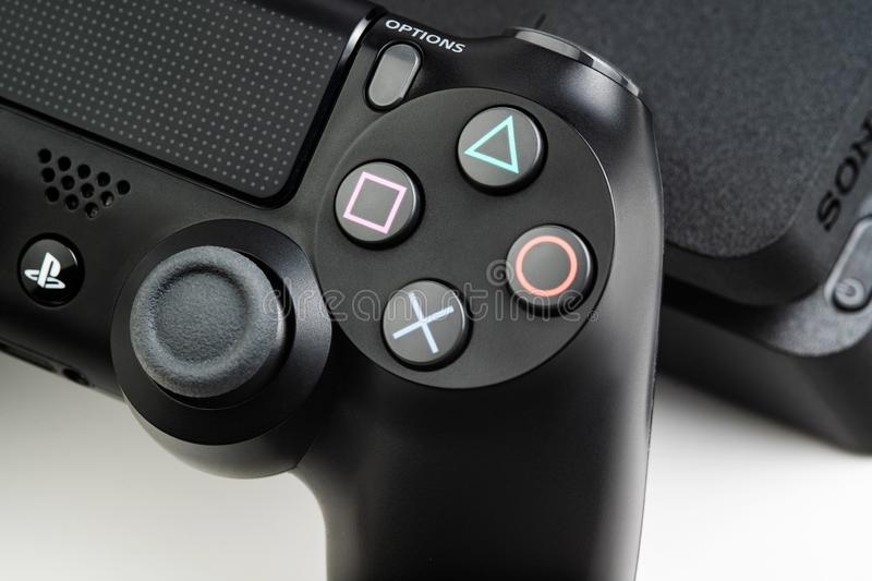 Stavropol, Russia - 17 March 2019. Closeup photo of video game console Sony Playstation 4 and controller Sony DualShok4 royalty free stock photography