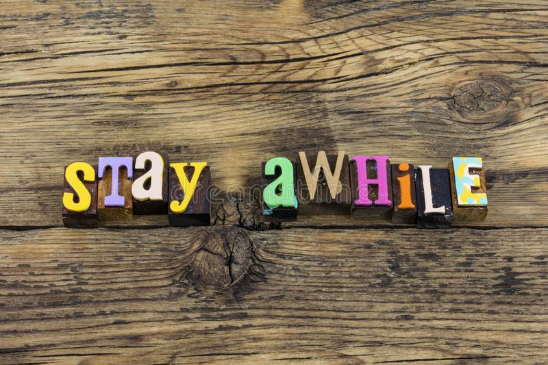 Stay awhile welcome home friendly relax typography phrase royalty free stock image