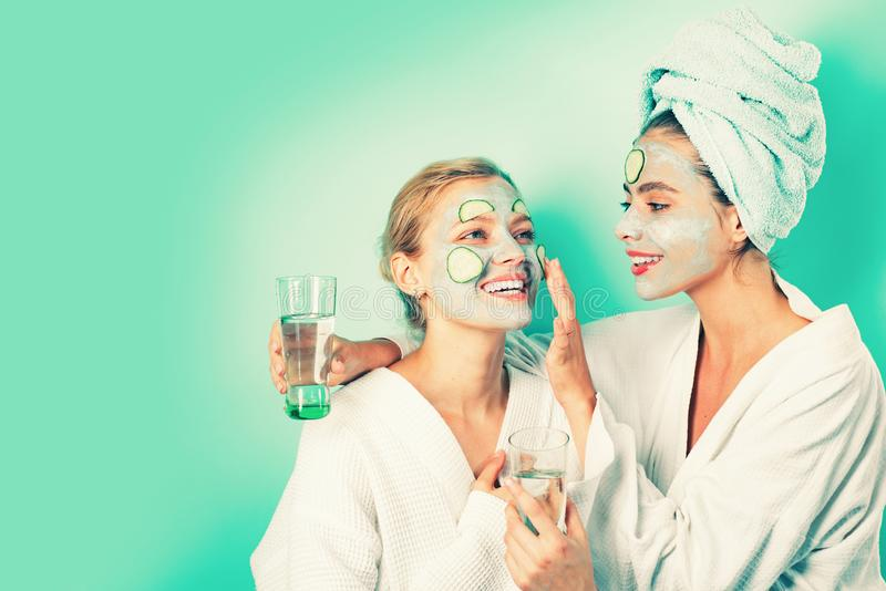 Stay beautiful. Skin care for all ages. Women having fun cucumber skin mask. Relax concept. Beauty begins from inside royalty free stock photos