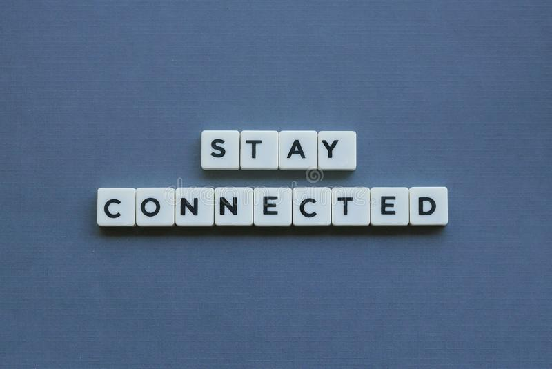 & x27; Stay Connected & x27; word made of square letter word on grey background royalty free stock photography