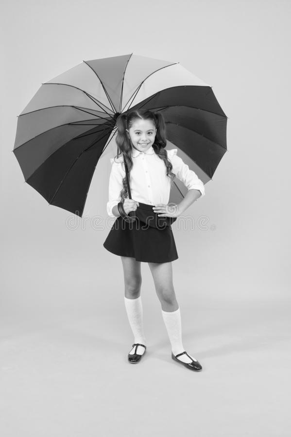 Stay dry. Fancy schoolgirl. Girl with umbrella. Rainy day. Happy childhood. Rainbow style. Kid happy with umbrella. Fall. Weather forecast. Fashion accessory royalty free stock photography
