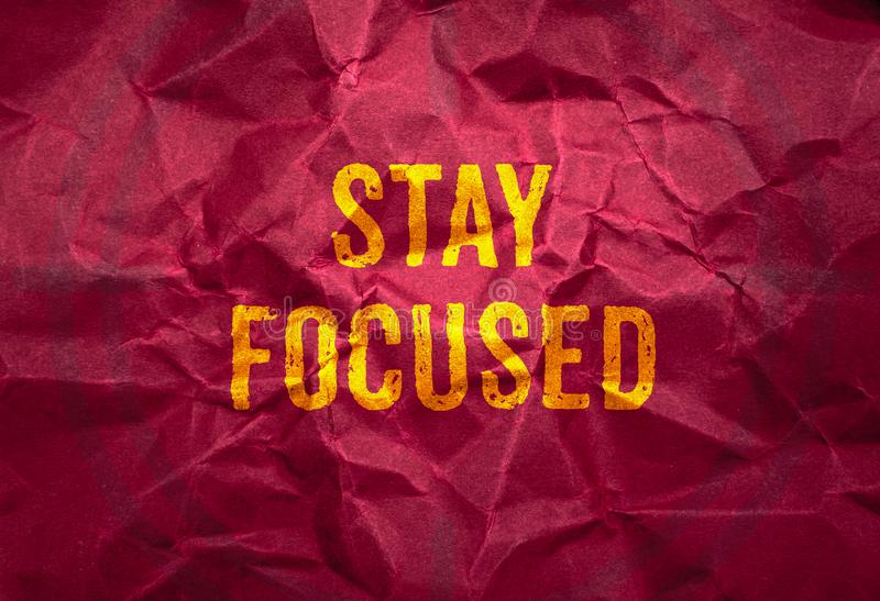Stay focus in gold texture on crumpled red paper background,business concept royalty free stock photo