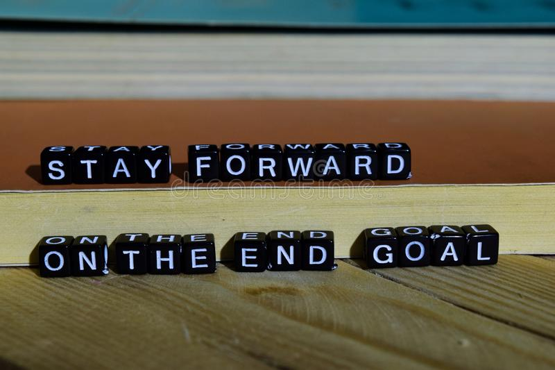 Stay forward on the end goal on wooden blocks. Motivation and inspiration concept royalty free stock images