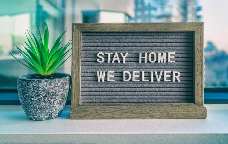 STAY HOME WE DELIVER Coronavirus social distancing restaurant business message sign. COVID-19 online delivery to home stock image