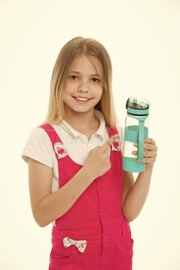 Stay hydrated. Girl cares about health and water balance. Girl on smiling face posing with water bottle isolated white. Background. Kid girl with long hair stock photography