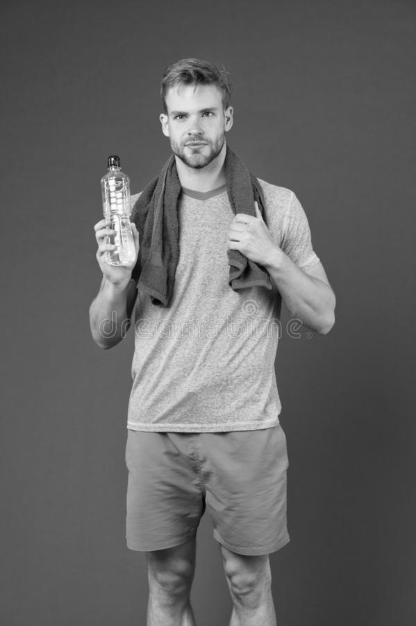 Stay hydrated. Man with towel on shoulders hold bottle. Athlete drink hydration mix with more electrolytes. Hydrates. Faster than water alone with an optimal royalty free stock photos