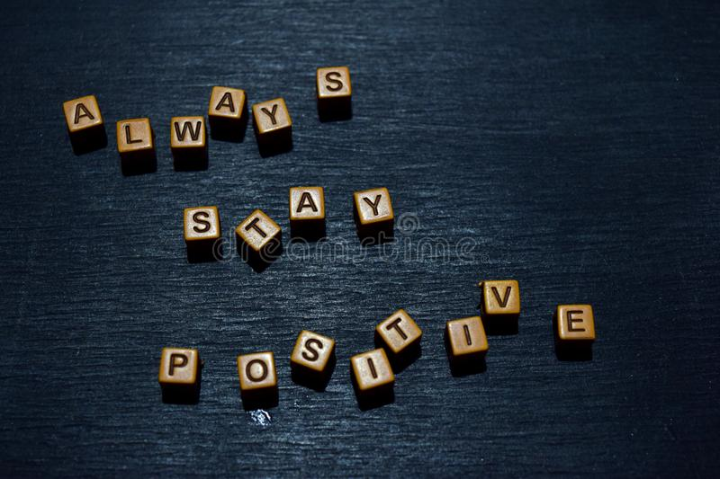 Always stay positive message written on wooden blocks. Motivation concepts. Cross processed image royalty free stock photo