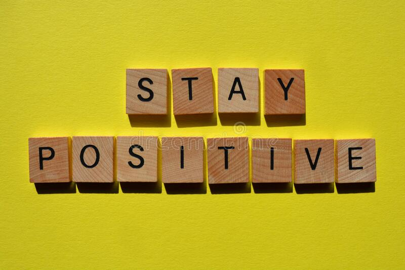 Stay Positive,  words on yellow. Stay Positive, motivational words to spread positivity on bright yellow background stock images