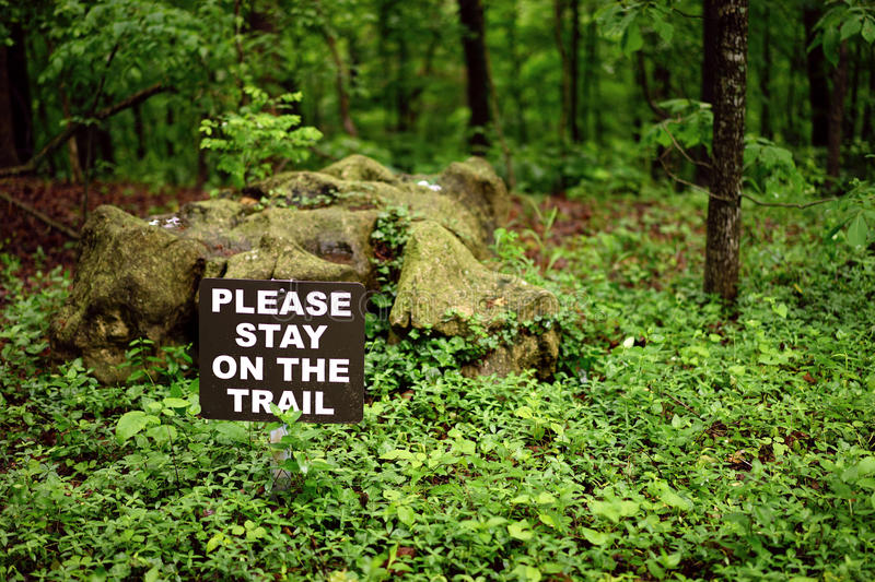 Stay on the trail. Trail sign directs hikers to a safe route that preserves the vegetation stock photo