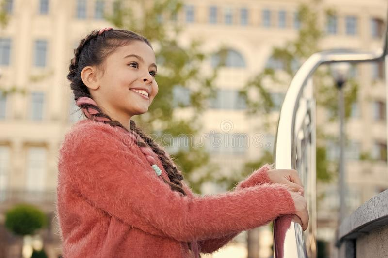 Staying beautiful. Small kid with fashion look. Little kid with brunette hair smiling in casual style. Adorable kid with royalty free stock image
