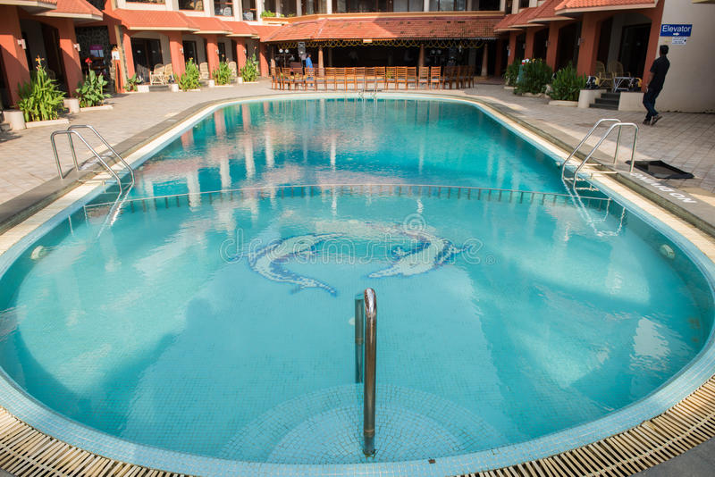 Staying at Luxurious Resort. View of a blue swimming pool at a resort in Kovalam, Thiruvananthapuram. Stairs leading to the swimming pool is seen here royalty free stock photography