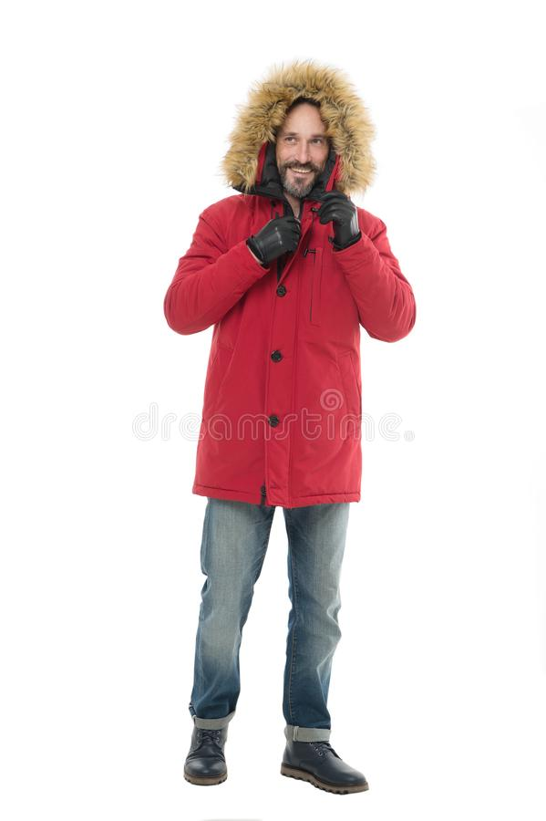 Staying warm in winter. Bearded man in winter fashion. Mature man in hooded coat isolated on white. Adult model enjoy stock photography