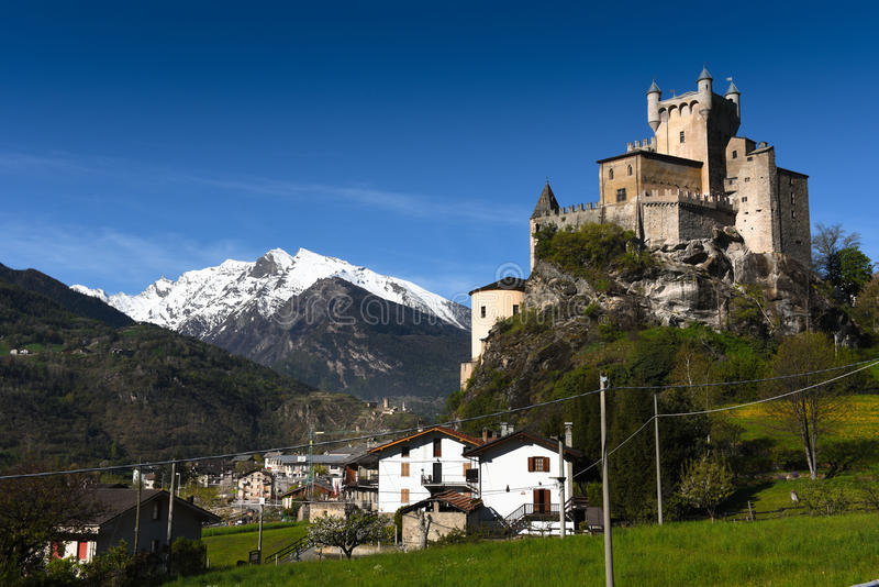 Ste Pierre & Mont Blanc. Castle and village of Saint Pierre with Mont Blanc in the disatance. Monte Bianco the White Mountain, is the highest mountain in the stock photo