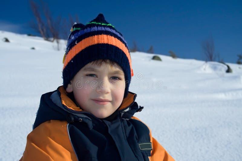 Steadfastly olhando o menino fotografia de stock royalty free