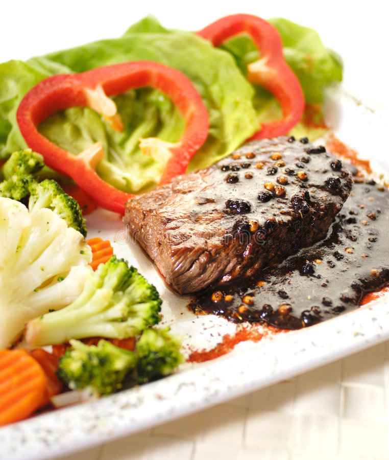 The Steak. Steak with pepper sauce and vegetable royalty free stock photography