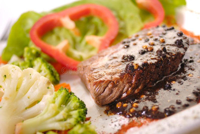 The Steak. Steak with pepper sauce and vegetable royalty free stock image