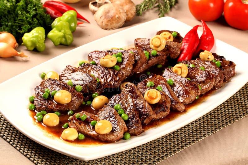 Steak with champignon. Gourmet food stock image